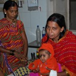 Shivkumari Yadav sits with daughters Prisha, two months, Mansi, three, and her mother Mahasin Bai